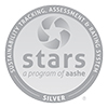 """Sustainability tracking assessment & rating system silver stars a program of aashe"" logo"