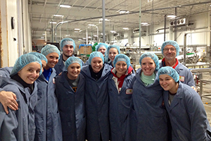 people in a group photo wearing coats and hairnets