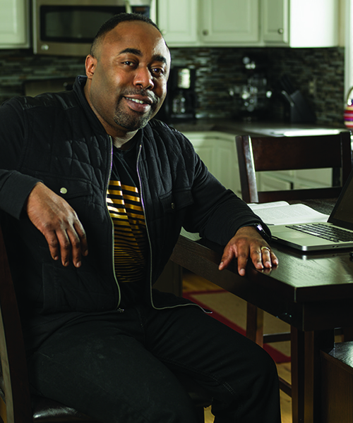 Gregory Richardson at kitchen table with laptop