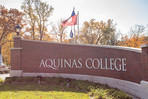 entrance Aquinas sign