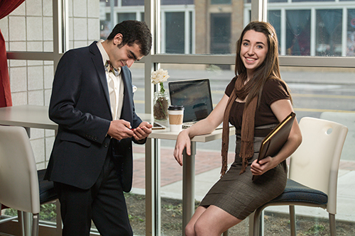 two students at table in business attire