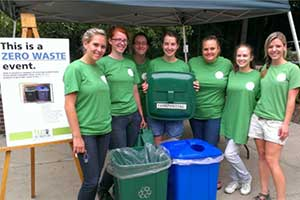 zero waste team standing by compost and recycle bins