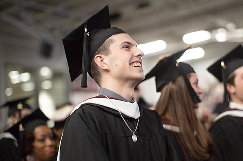 student smiling at graduation