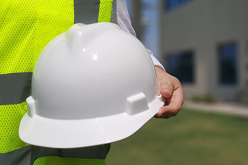person holding hard hat