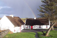 buildings in Ireland with a rainbow