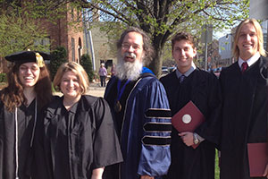 graduates with a professor