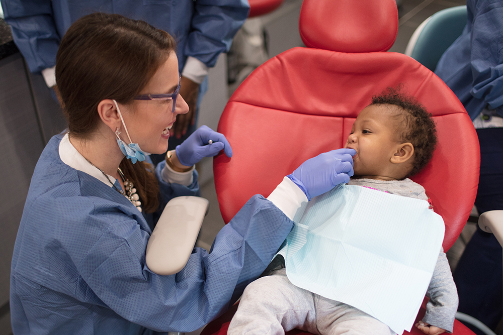 dentist working on childs teeth