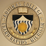 """Aquinas College Grand Rapids, Michigan"" seal"
