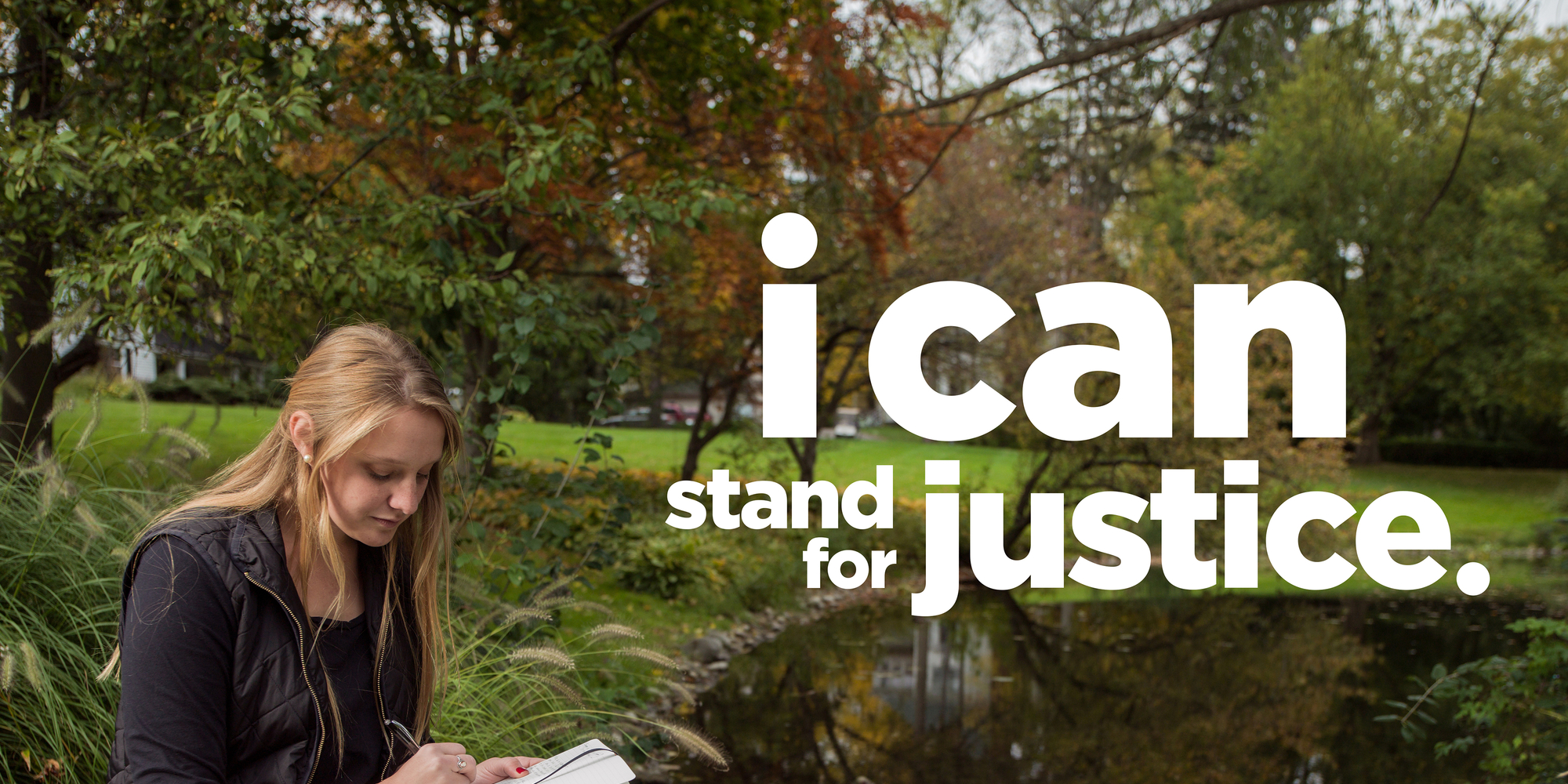 """student reading a book """"ican Stand For Justice"""""""