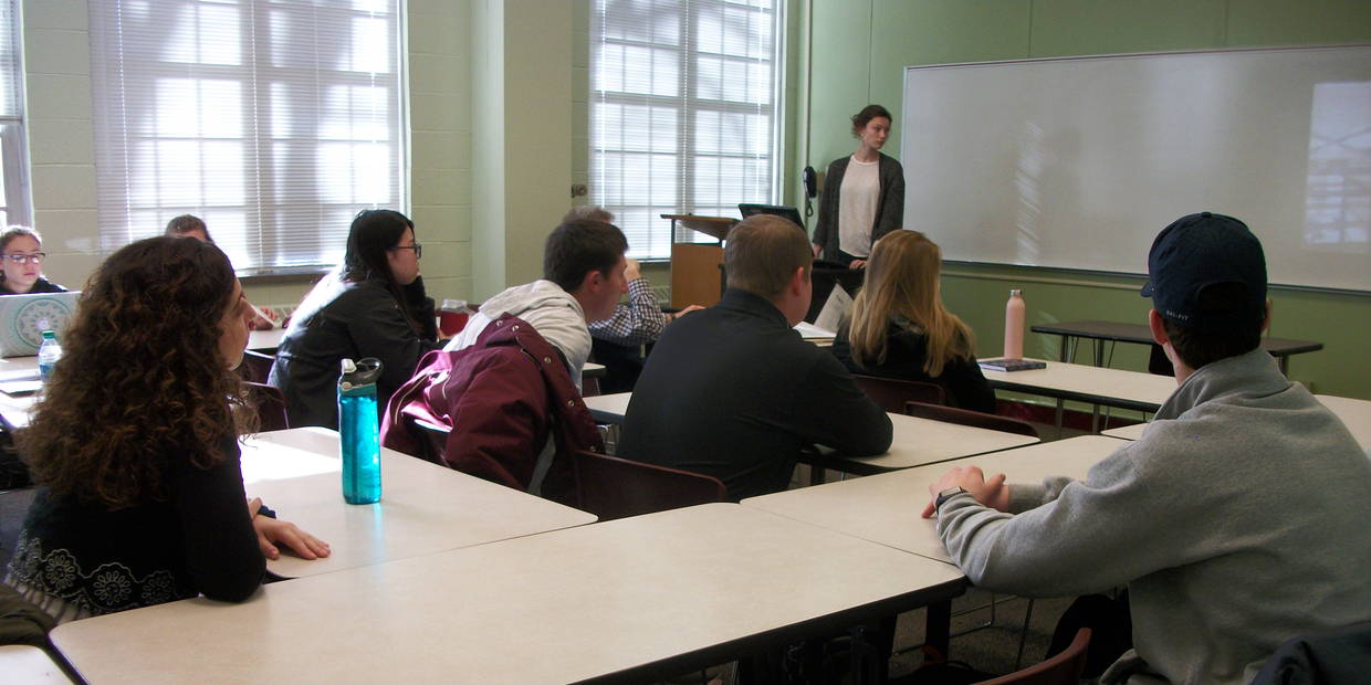 students and a professor in a classroom