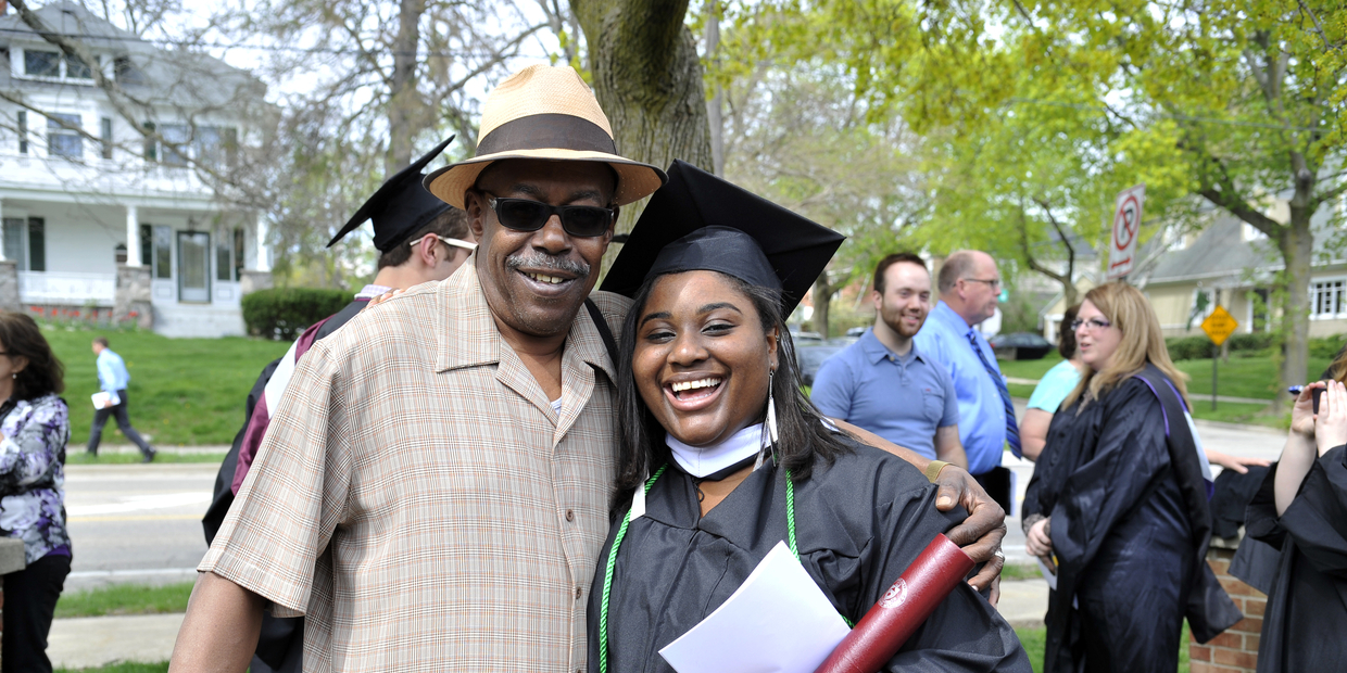 Student with parent at graduation