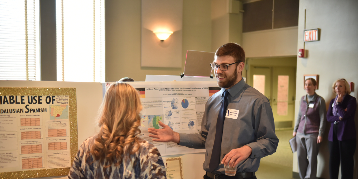 student talking about their research