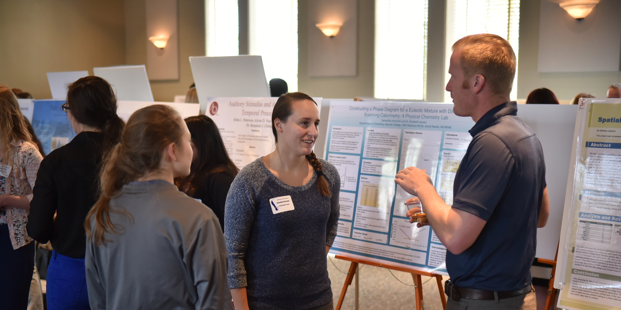 students talking about their research