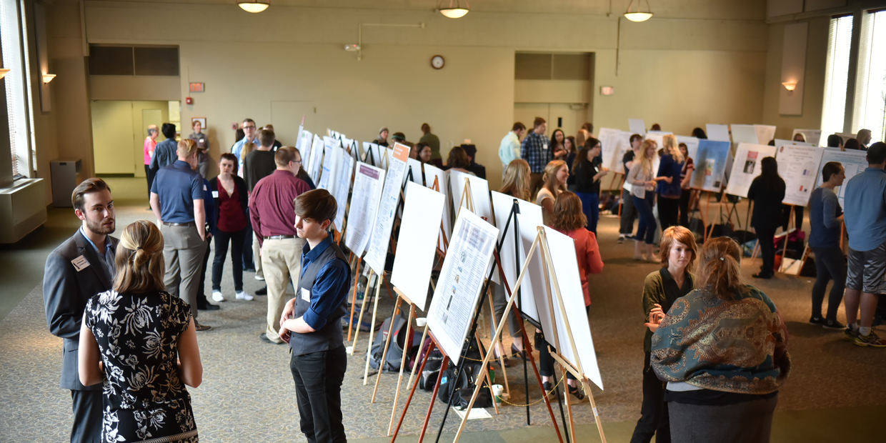 students and others at student research poster symposium