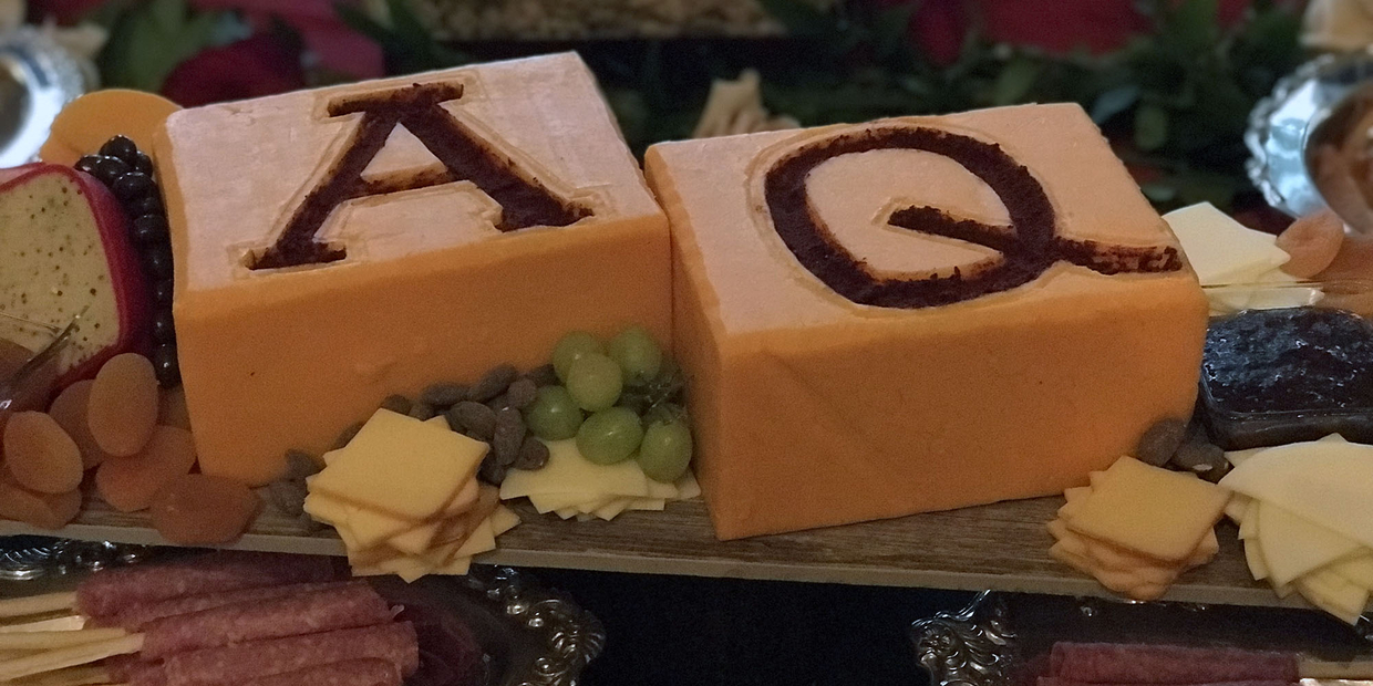 "Cheese Plate with letters ""AQ"" carved into it"