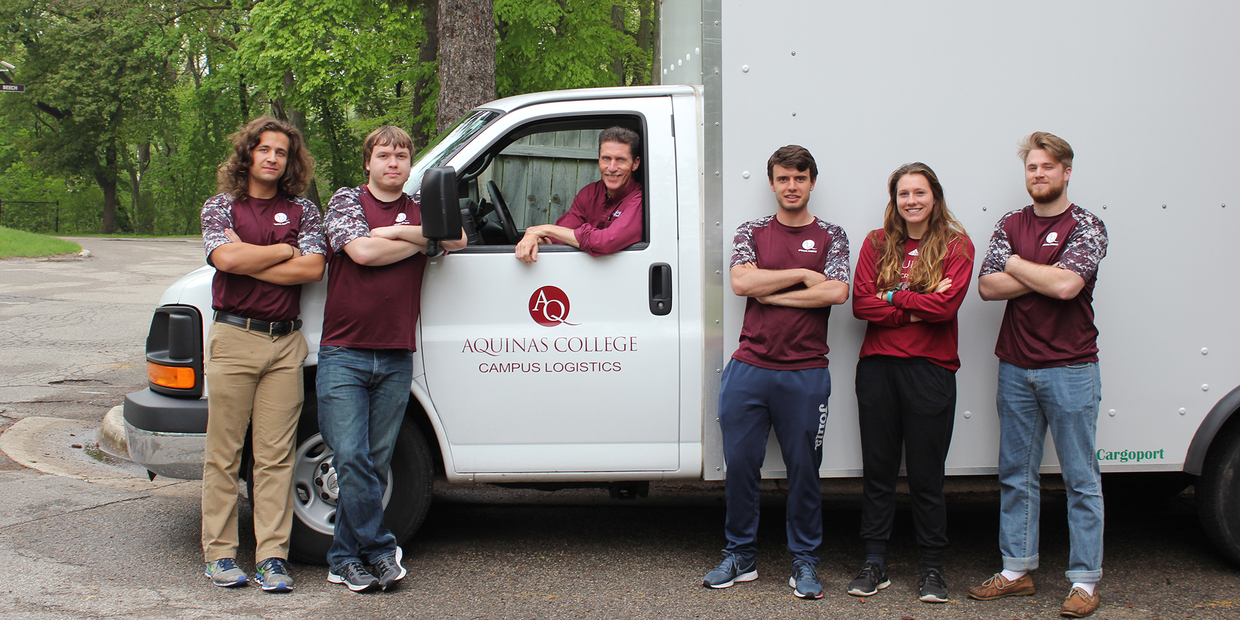Campus Logistics team in front of truck