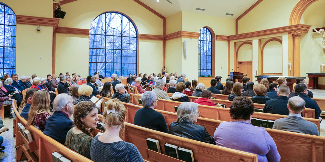 Our Lady Seat of Wisdom chapel with full congregation