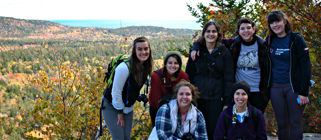 students smiling in the woods