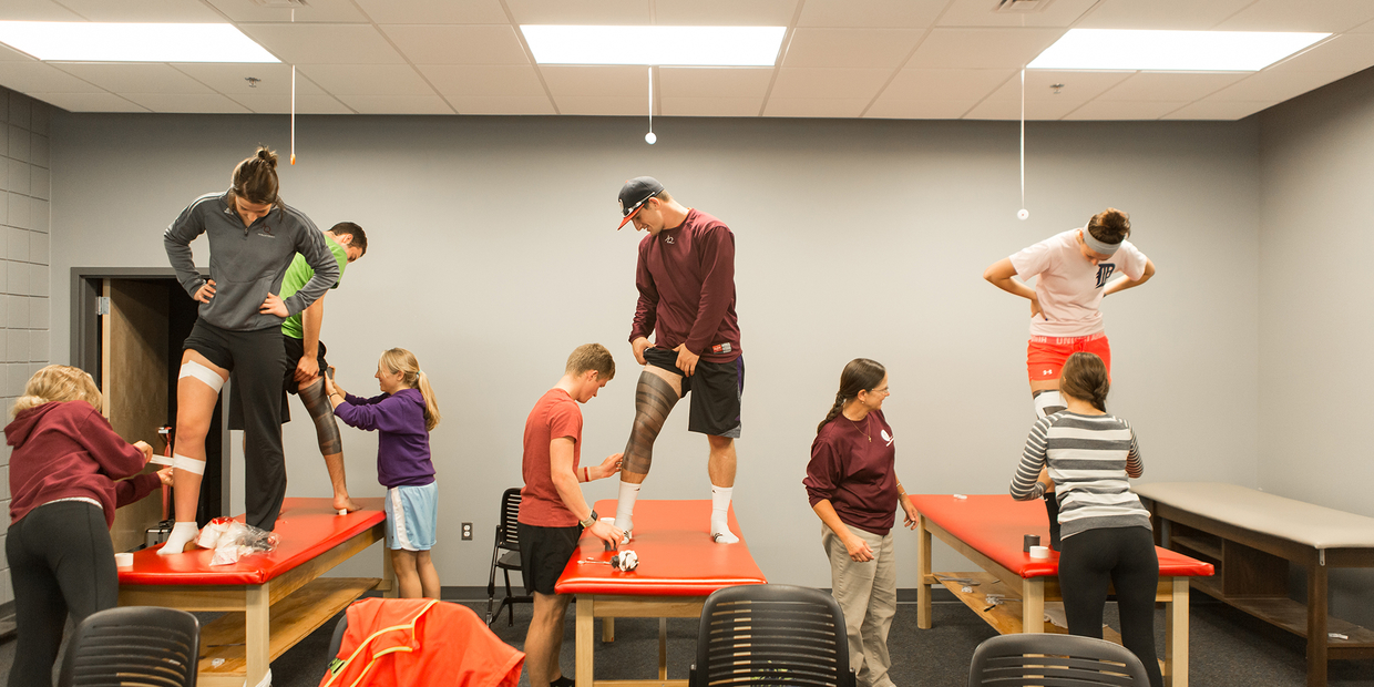students practicing exercise science