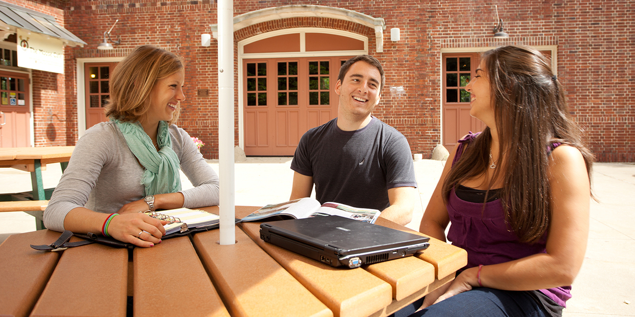 students sitting at a table outside of the Moose