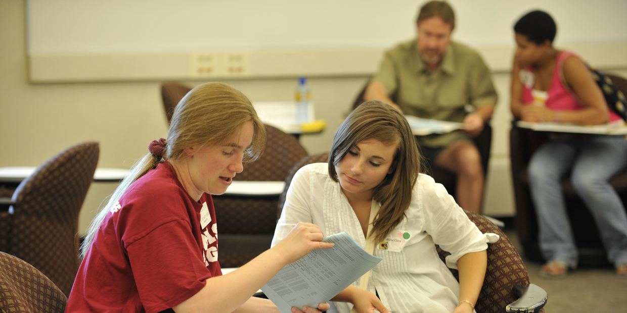 student talking with a guidance counselor in a classroom