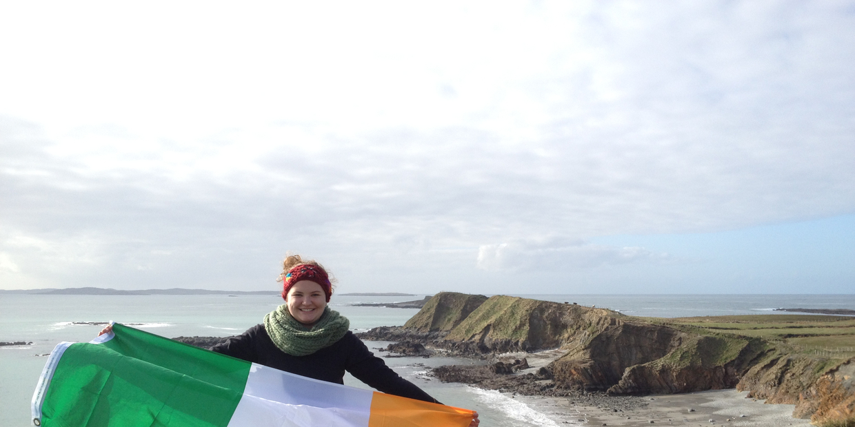 Student holding Irish flag