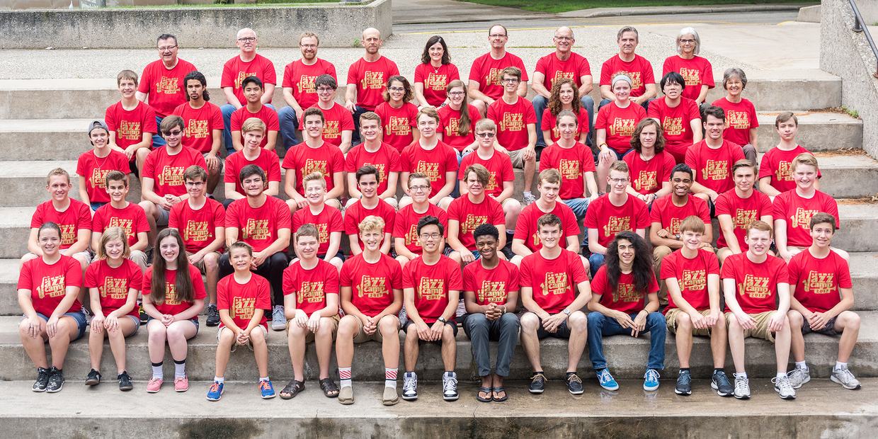 Group photo with students wearing matching red jazz band tshirts