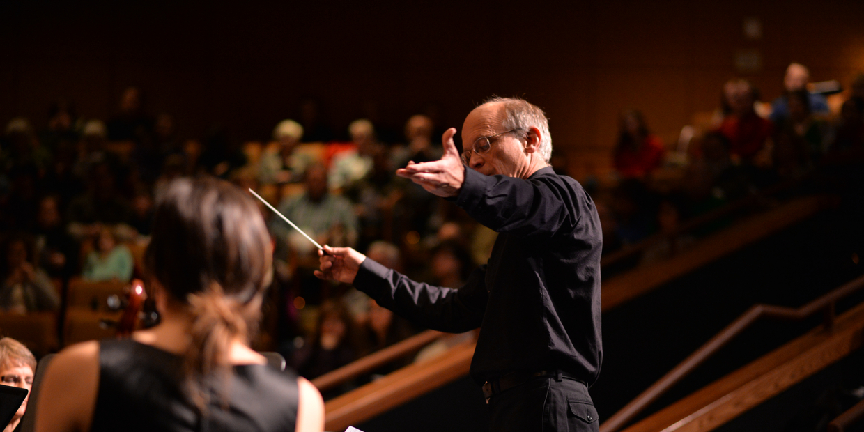 conductor conducting a concert