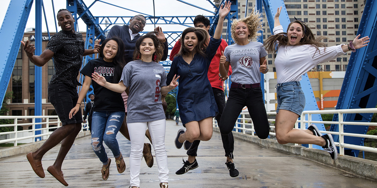 8 students on blue bridge jumping