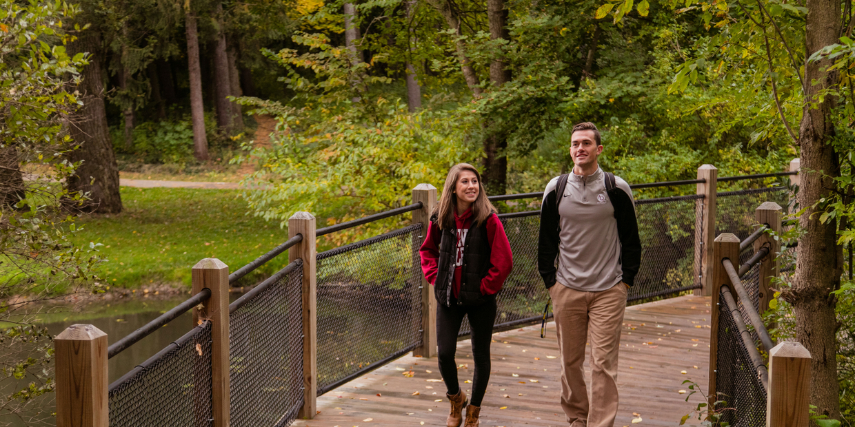 two students walking on a bridge
