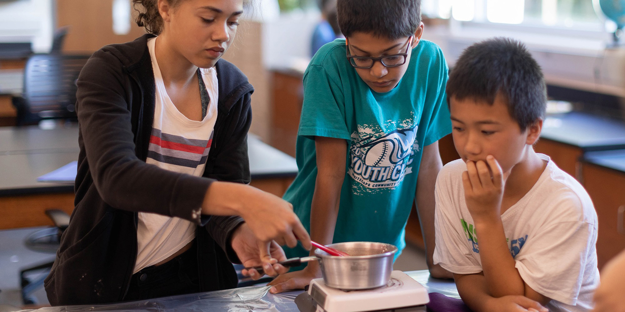 3 students working on science experiment
