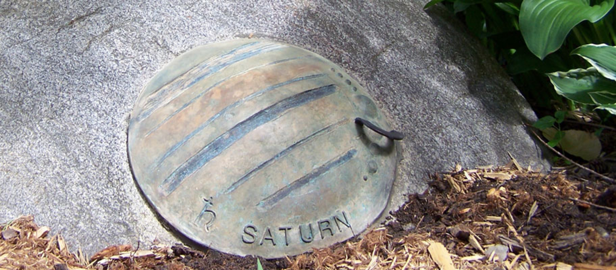 Saturn on a rock
