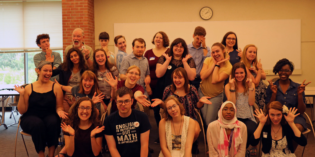 group photo of the writing center team acting goofy