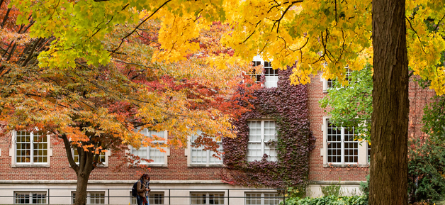 Orange-, yellow- and red-leafed trees in front of Academic Building