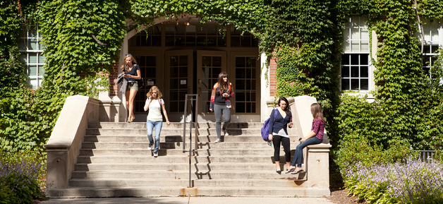 students on steps outside the Academic Buidling