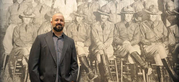 Chris LaPorte in front of his large drawing
