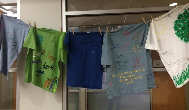 Hand-decorated t-shirts hanging from a clothesline