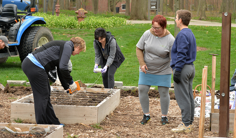 4 women working in a community garden