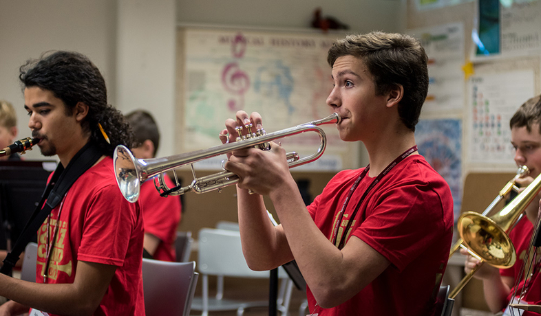 student playing trumpet