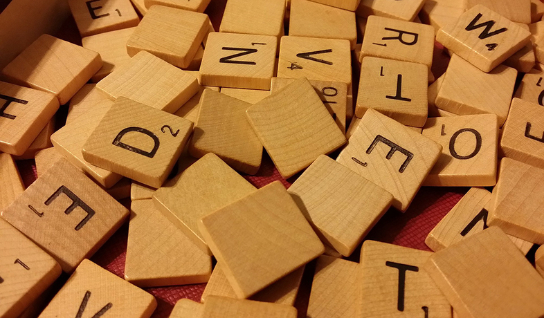 scrabble chips in box
