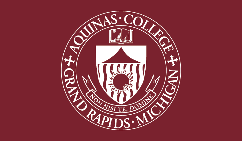 """Aquinas College Grand Rapids Michigan Non Nisi Te Domine"" graphic"