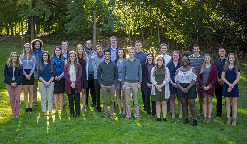 Student senate standing on grass