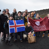 Group of students and professors standing on road in Iceland