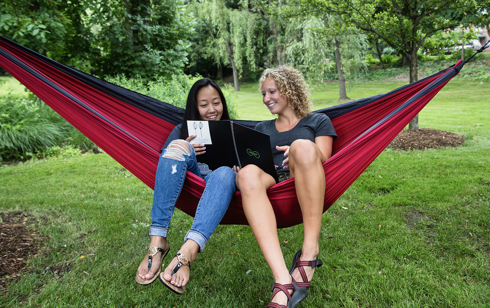 students in hammock together