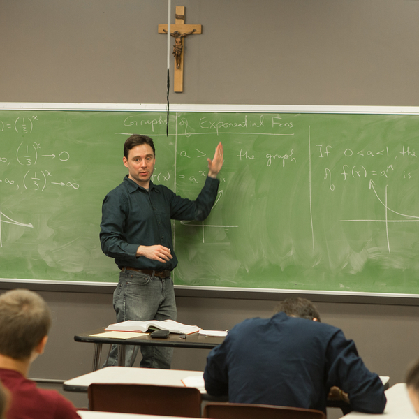 Professor teaching on a chalkboard