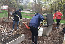 students digging on Earth Day
