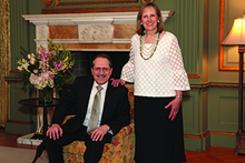 man sitting and woman standing